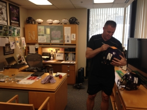 Fitz signs helmet in office